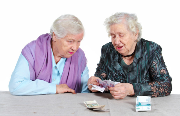 Two Grandma is counting Russian money.