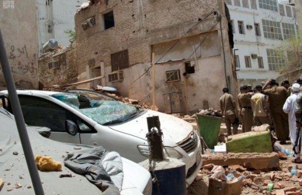 Saudi security forces work at a scene after a suicide bomber blew himself up in Mecca, Saudi Arabia